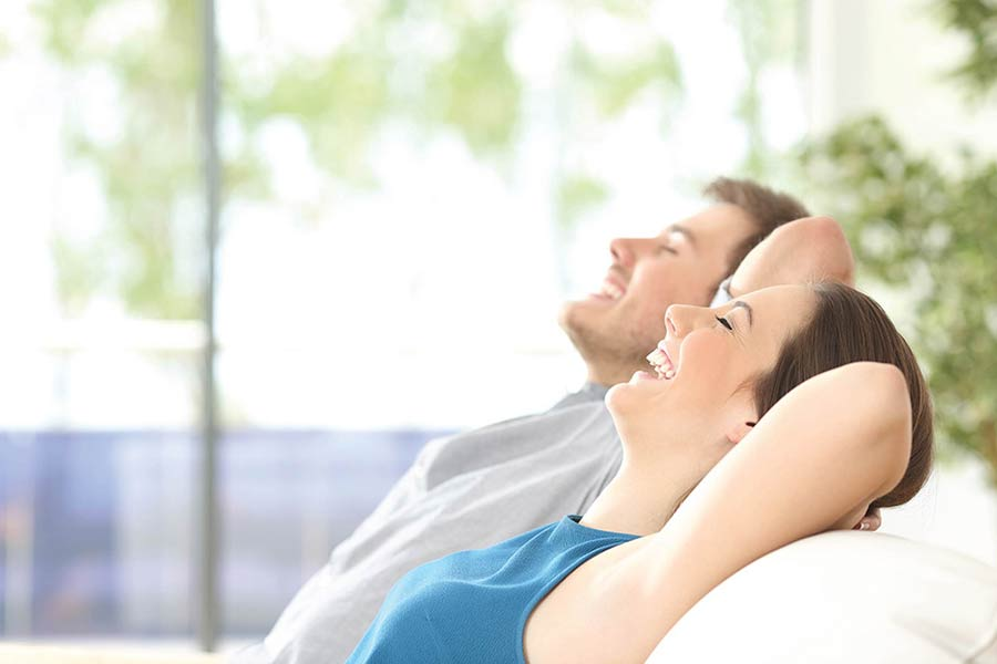 couple doing deep breathing instead of smoking